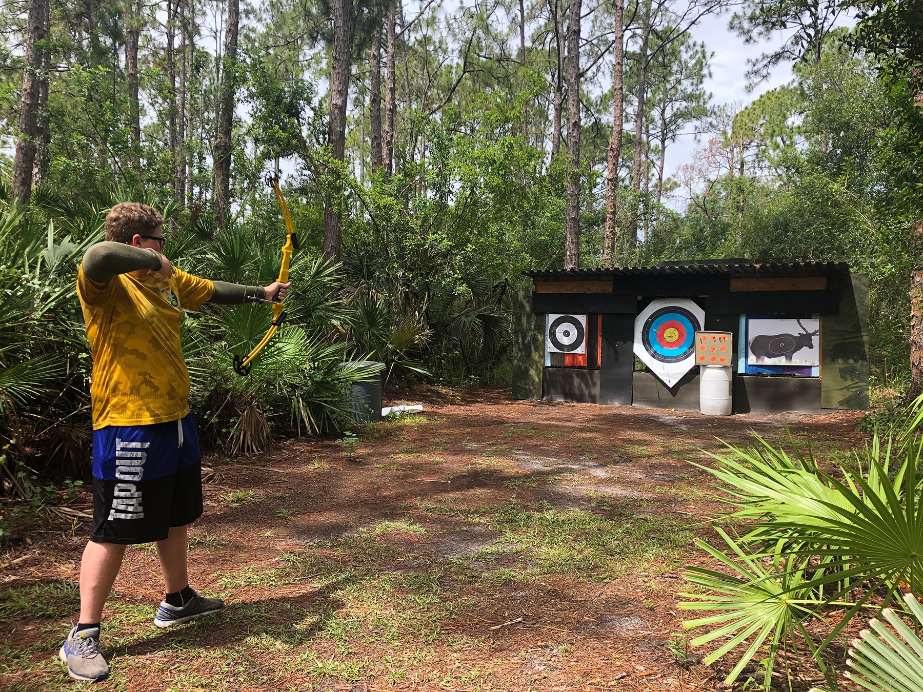 image of a transition teen shooting archery during a summer experience