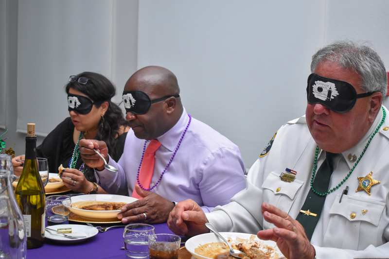 a group of guests enjoying a meal under blindfold at the Dining in the Dark event