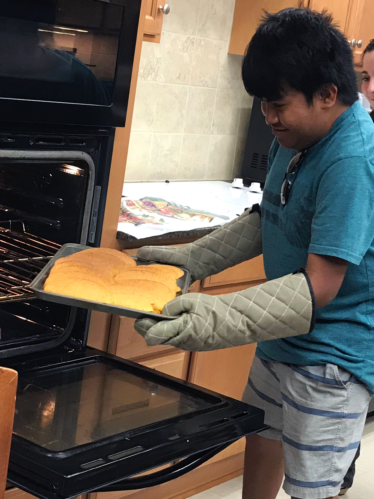an image of transition student Enrique in the kitchen baking bread